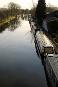 Narrowboats moored along the Grand Union canal