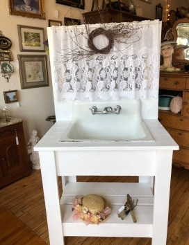 Beautiful potting table with antique sink.