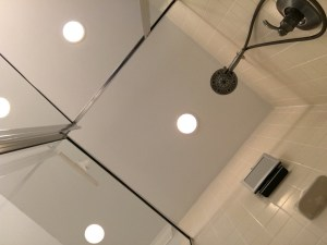 view from floor over shower stall to ceiling