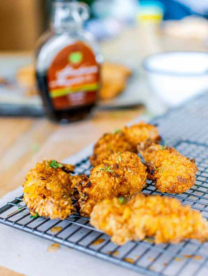 Super easy chicken strips that are healthy for kids and quick to make. This ridiculously tasty baked chicken strips recipe is worth switching from store bought. #chicken #familyfood #ovenfried #chickenstrips
