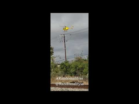 VIDEO: Sure would Not want to be that guy in the bucket! Helicopter High Voltage Cabling and lineman