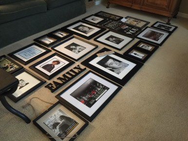 Framed photos on the floor that mock up how the gallery wall will look