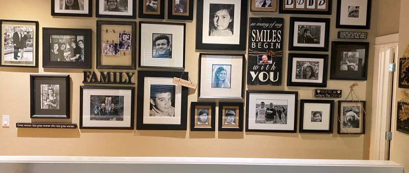A photo of a finished gallery wall displaying family photos and decor