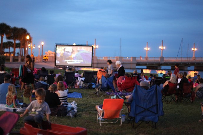 Movies by the Bay opens June 1, 2016 and continues each Wednesday through the summer with FREE films on the St. Augustine bayfront near the Bridge of Lions. Photo shows the 2015 movie series. By Renee Unsworth