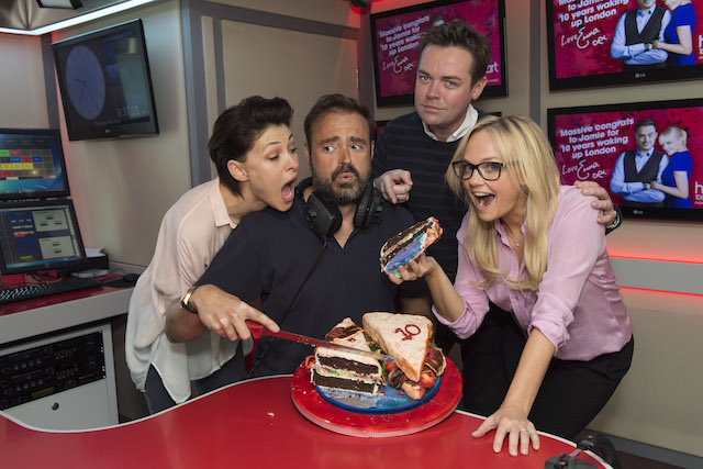 Jamie Theakston celebrates 10 years on Heart Breakfast with co-host Emma Bunton, fellow Heart presenters Emma Willis and Stephen Mulheron and a bacon sandwich shaped cake, at the Heart Studios in central London. HANDOUT IMAGE, EDITORIAL USE ONLY