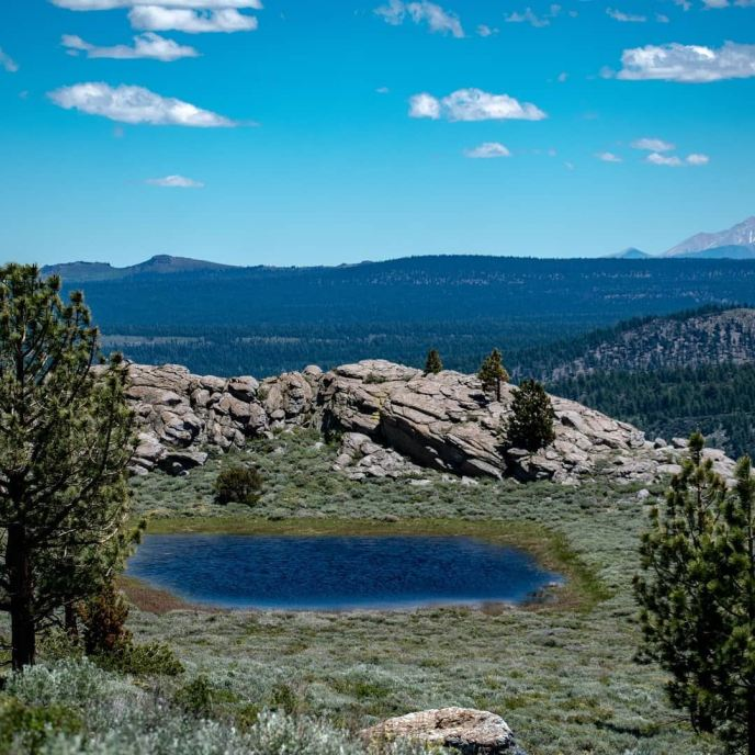 A beautiful tarn beckons from a bench high above June Lake.