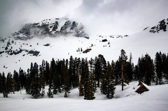 Deep in Sequoia National Park spring is slow to arrive at 9,000 ft. The Pear Lake Ski Hut starts the long process of melting out after a big winter below moody skies.