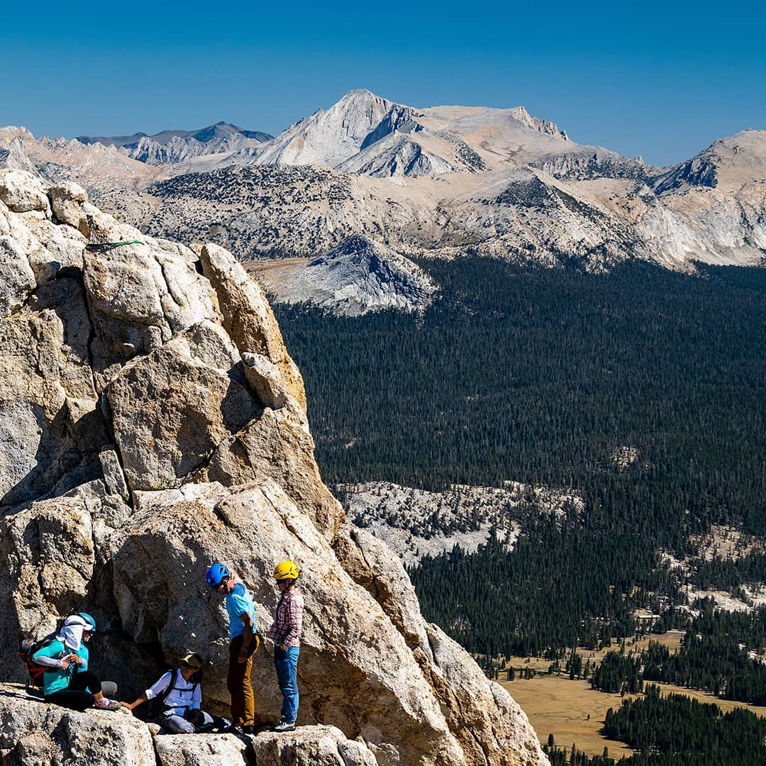 A party of climbers stymied by the last twenty feet of Unicorn Peak, high above Tuolumne Meadows.