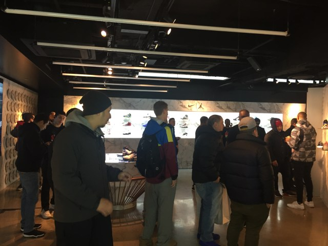 People at the event in front of the wall of classic Jordans