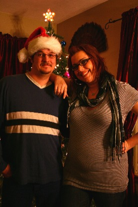 Image shows a Christmas pregnancy announcement.
