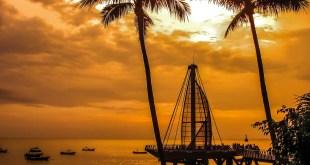 Los Muertos Pier during stunning Puerto Vallarta sunset.