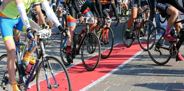 Group of cyclists with racing bikes during the start of the bicycle race called GranFond