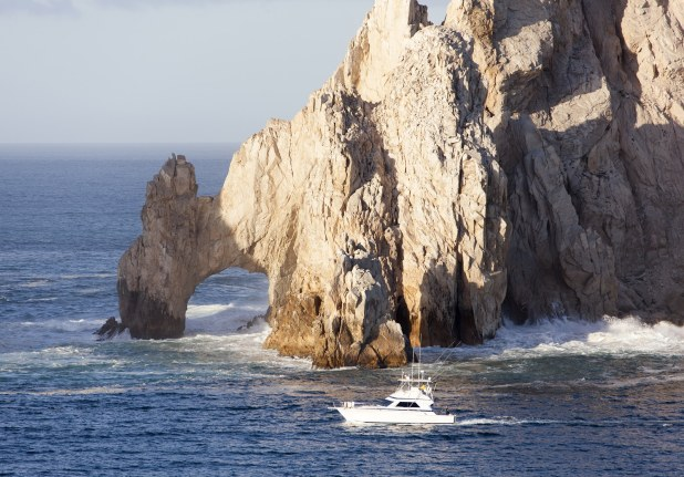 The boat passing by famous rock arch