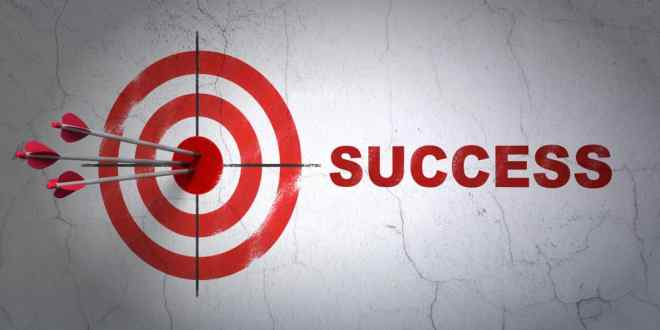 Finance concept: target and Success on wall background