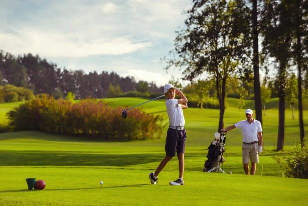 Boy practice golf at Cabo San Lucas