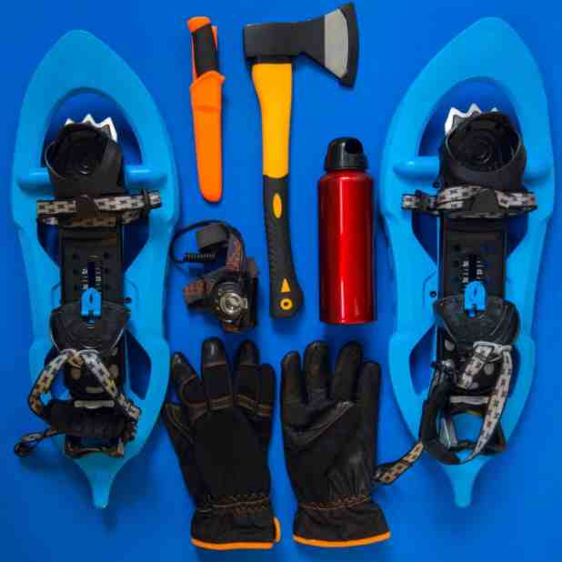 Kit of gear for hiking, adventure and survival in wilderness during winter