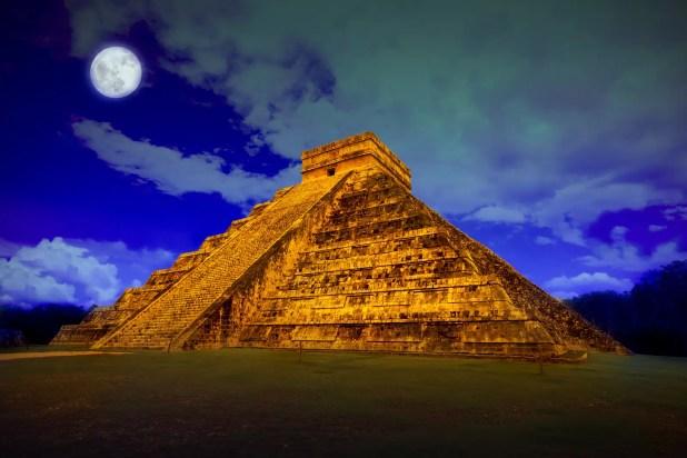 The pyramid of Kukulcan at Chichen Itza at full moon