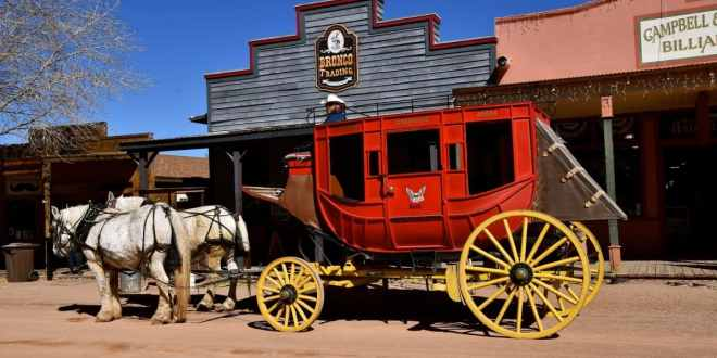 The white Percheron horses and red carriage is in Tombstone AZ