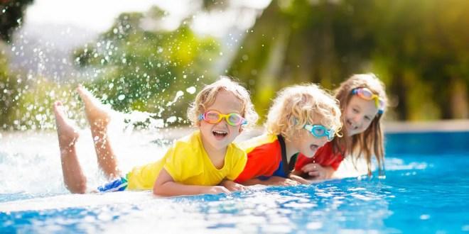 Kids play in swimming pool.