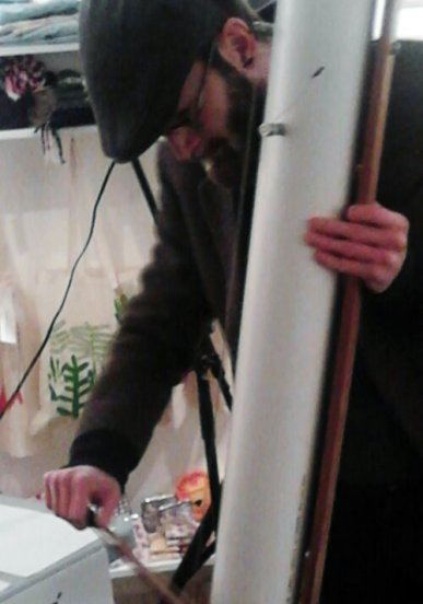Lee playing his handmade Tritona