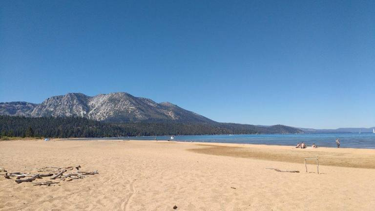 Wide, yellow, sandy beaches of South Lake Tahoe at Kiva Beach, for Ellen Blazer's travel blog To Travel and Bloom