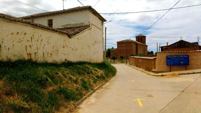 Following the yellow arrows of El Camino de Santiago into the next small town, for Ellen Blazer's travel blog To Travel and Bloom