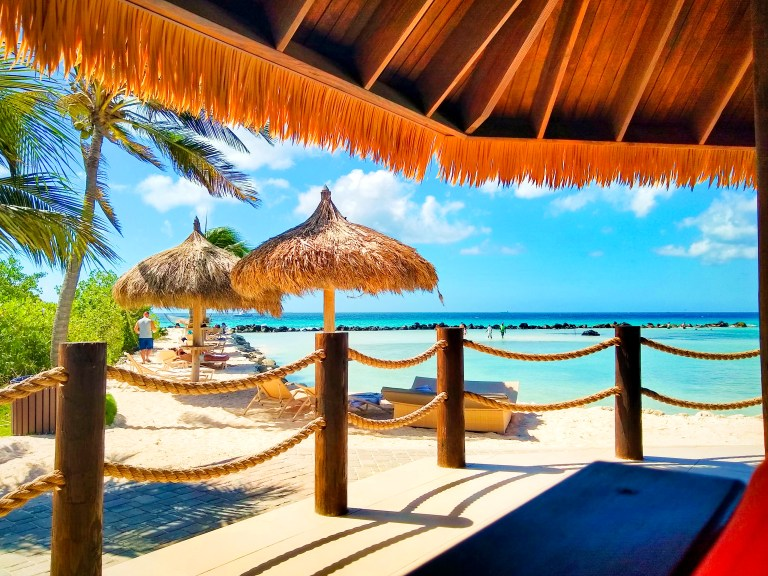 Flamingo Beach restaurant on Renaissance Island, Aruba for Ellen Blazer's travel blog To Travel and Bloom