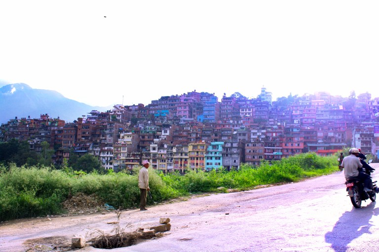 A passing motorbike in Kathmandu, Nepal, for Ellen Blazer's travel blog To Travel and Bloom