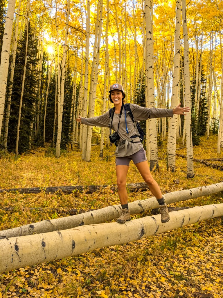 Ellen Balancing on an Aspen - 3 Best Places for Fall Colors in Crested Butte, Colorado