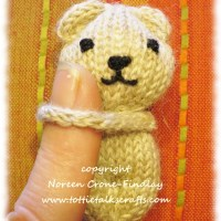 Tiny Teddy Bears that hug the hand that holds them