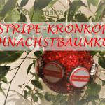 Weihnachtsbaumkugel mit Kronkorken von jamaikanischem Red Stripe Bier verziert