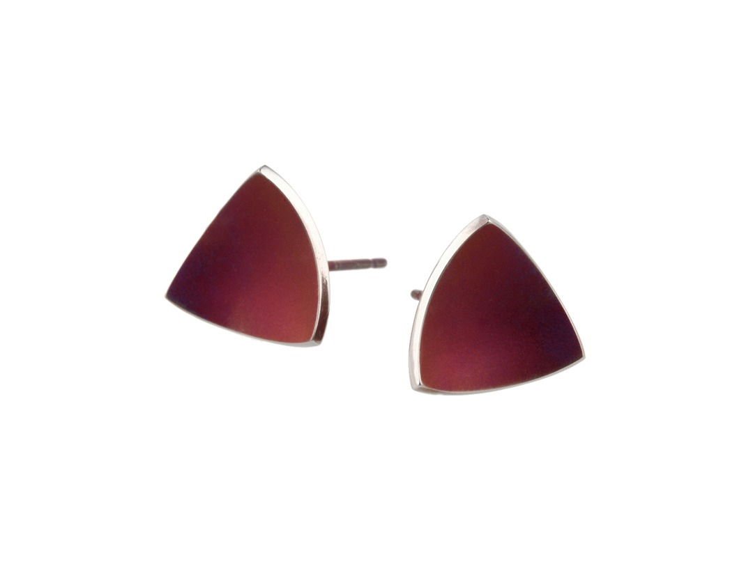 Triangular dome studs on TouchTitanium.com Our triangular dome studs radiate elegance in an effortless combination of colour and finish. Handmade in titanium measuring 12mm diameter with titanium butterfly clasps. Available in a range of colours. These medium sized studs are hypoallergenic and safe to wear for all skin types.