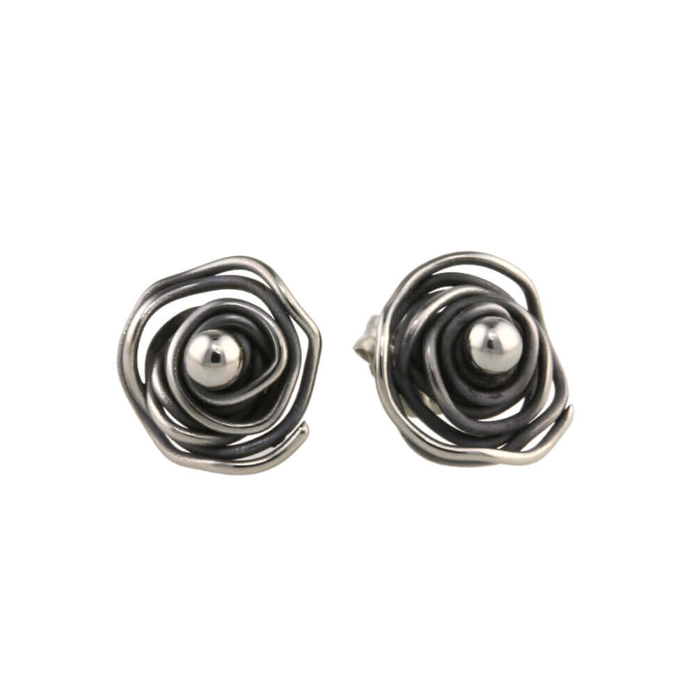 Cabbage leaf twist studs on TouchTitanium.com <p>A real conversation starter, these cabbage leaf twists look fantastic in a wide range of colour options. These perfect little studs are 100% hypoallergenic, 100% titanium and safe to wear for all skin types.</p>