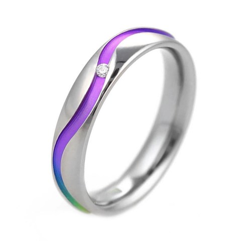 Hypoallergenic rainbow titanium ring with single diamond.