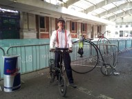 This is my entire outfit, with my bike. A penny-farthing is in the background.