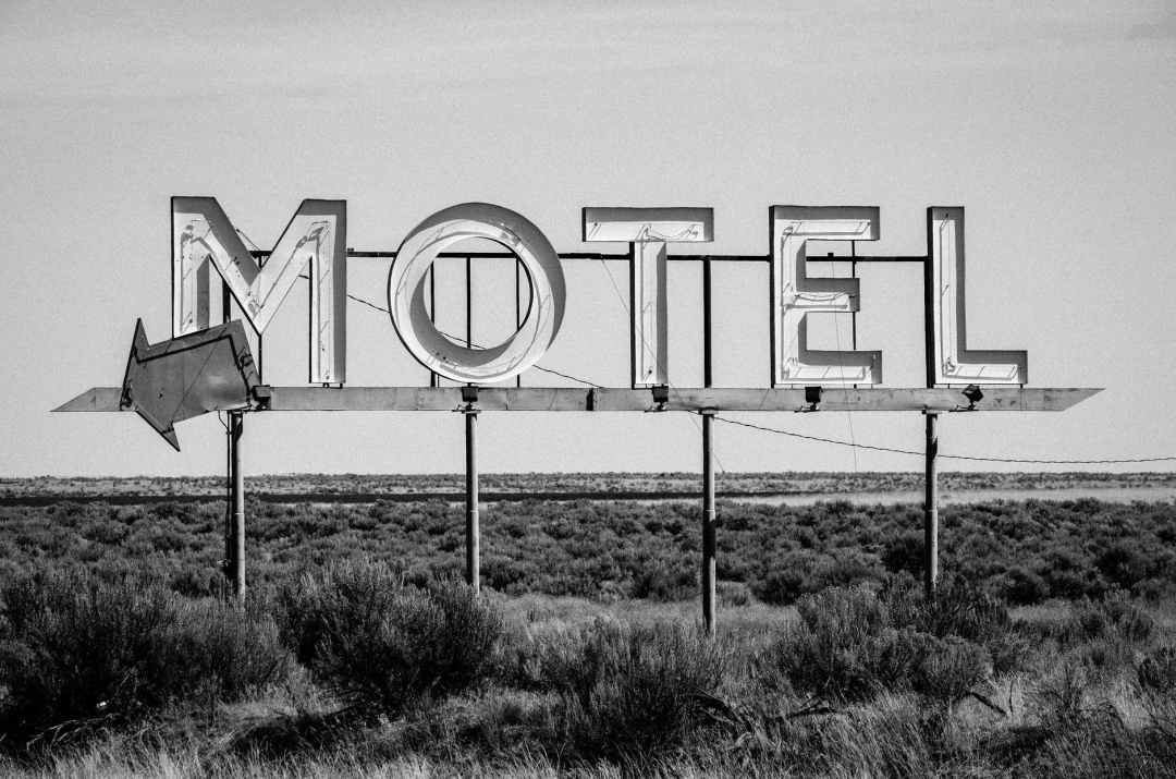 grayscale photo of motel signage what is a motel