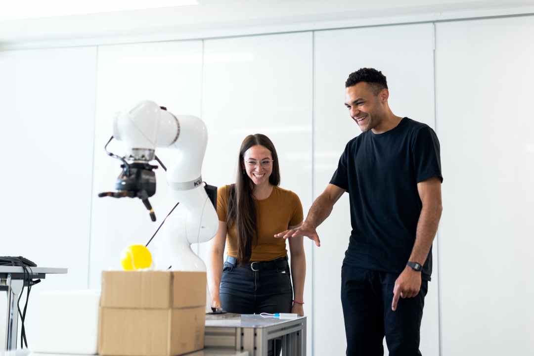 engineers developing robotic arm jobs in travel and tourism