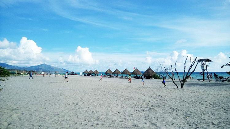 Crystal Beach Resort Zambales - vast sand with nipa huts