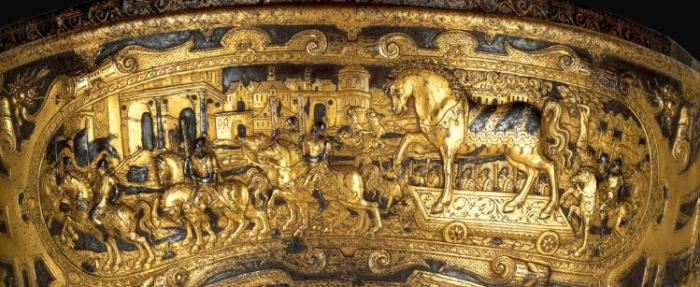 16th-Century saddle shows the Trojans bringing the wooden horse into their city, unaware of the Greek enemies hidden inside. Ambrosiana Gallery, Milan