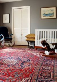 A modern kid room decorated with an oriental Turkish carpet