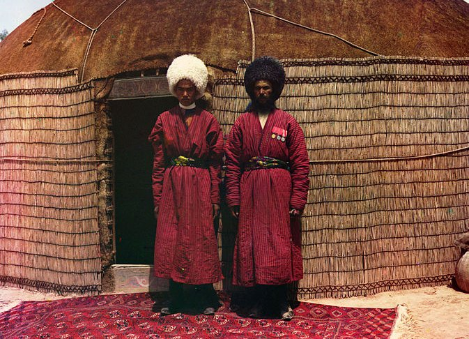 Two Turkish Nomads on a Turkish Carpet in front of a Classic Turkish Yurt