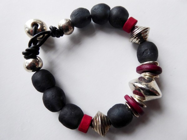 meryl lusher,blackceramic,silver and redbeadbangle