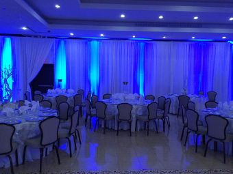 dining area with tables, chairs and event curtains and drapes