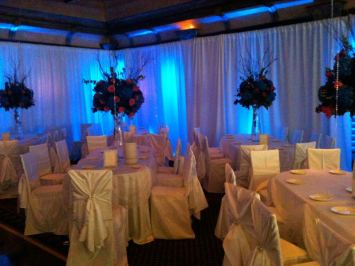Table-linens-chair-covers-floral-centerpieces-and-wall-draping