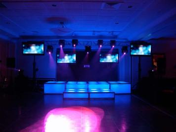 blue LED stage decks, video screens, theatrical lighting