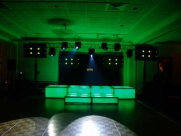 green LED stage decks, video screens, theatrical lighting