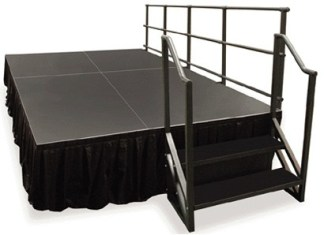 black portable stage with steps and railings