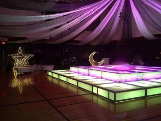 LED-double-decker-Dance-Floor-with-sheer-ceiling-treatment-and-star-moon-props