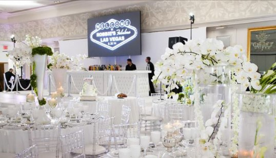 Las-Vegas-Fundraiser-event-with-floral-centerpieces-full-bar-video-sign-and-acrylic-chairs