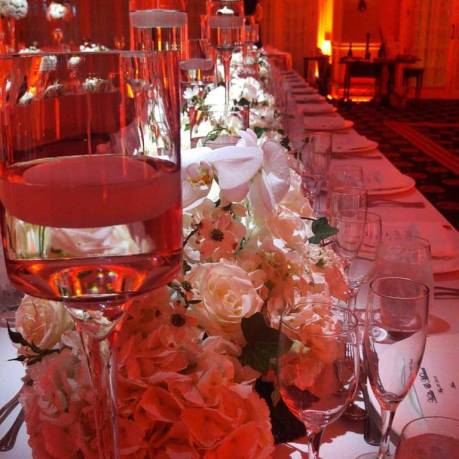 Long-buffet-table-with-pinspot-lighting-over-centerpieces-and-floating-candles